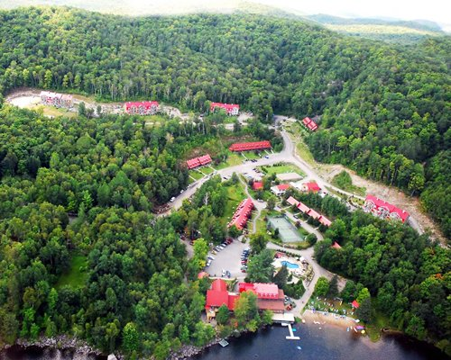 An aerial view of the resort properties surrounded by wooded area.