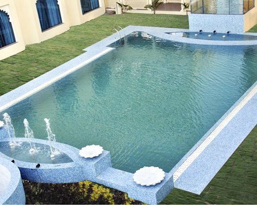 Outdoor swimming pool with fountains.