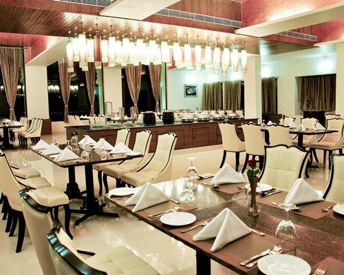 An indoor restaurant at Club Mahindra Udaipur.