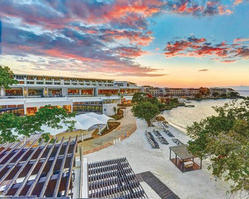 Exterior view of TravelSmart at Royalton Negril at sunset.