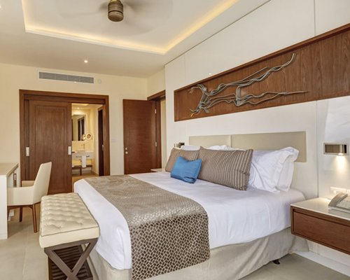 A well furnished bedroom with a king size bed.