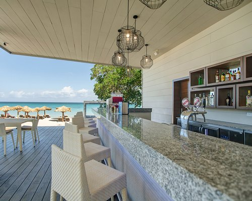 A well equipped open air bar with beach view.