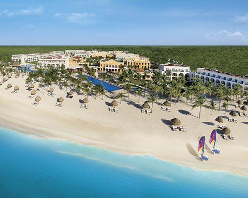 The Dreams Tulum Resort & Spa with an outdoor swimming pool alongside the beach.