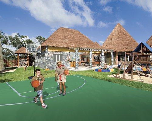 An outdoor basketball court alongside resort units.