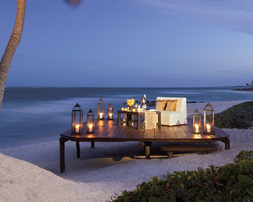 Beachside private dining area with a love seat.