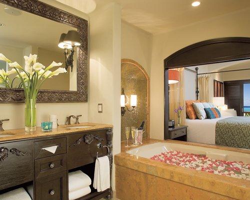 A well furnished bathroom with sink and bathtub.