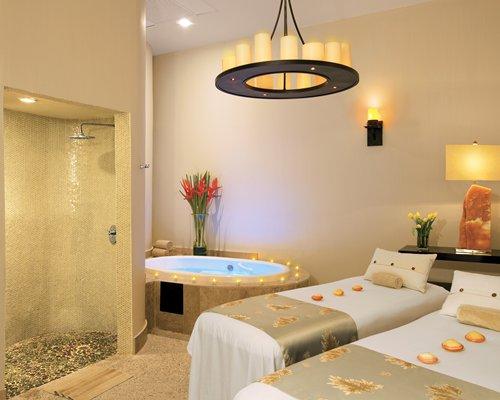 An indoor spa area with a bathtub.