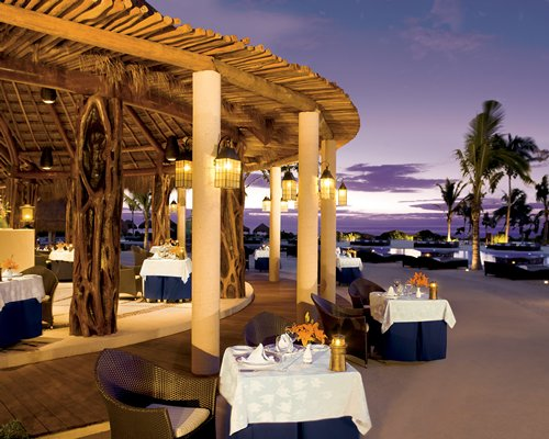 An outdoor fine dining restaurant at dusk.