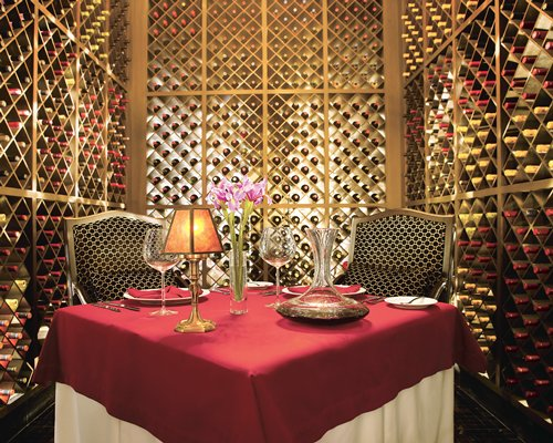 A dining table covered with wine rack.