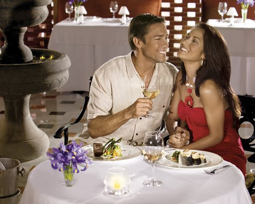 A couple dining at an indoor fine dining restaurant.