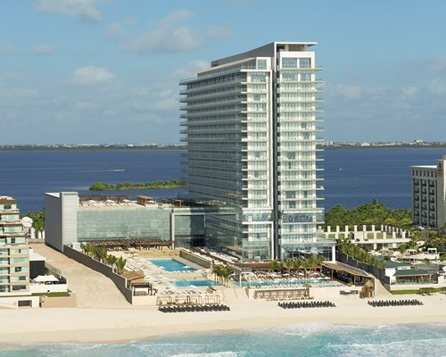 An exterior view of the resort property surrounded by the water.