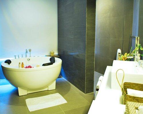 A bathroom with shower and bathtub.