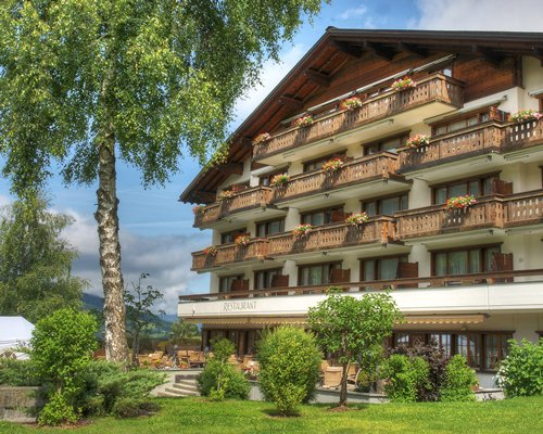 Scenic exterior view of Sunstar Hotel Klosters with multiple balconies.
