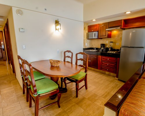 A well furnished living room with a balcony dining area and ocean view.