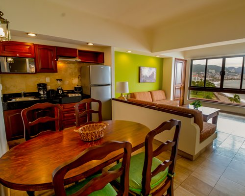 A well furnished living room with a pull out sofa television and balcony.