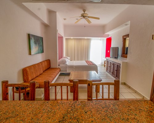 A well equipped kitchen with a microwave oven and a breakfast bar.