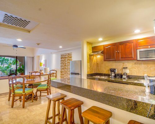 A well furnished bedroom with a television shower bathtub balcony and ocean view.