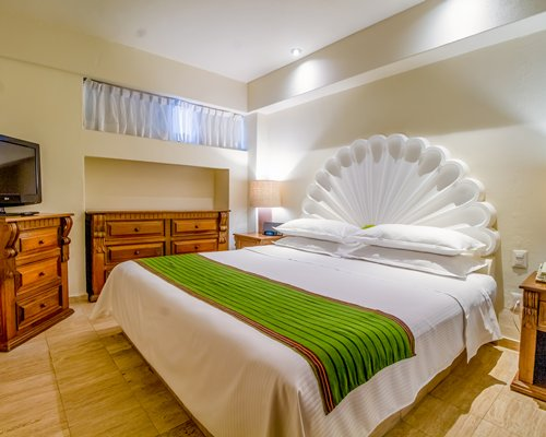 A well furnished bedroom with two beds and outside view.