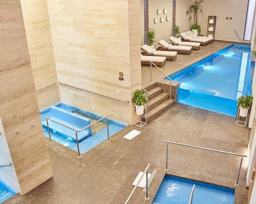 Bird's eye view of the pool and plentiful lounge areas.