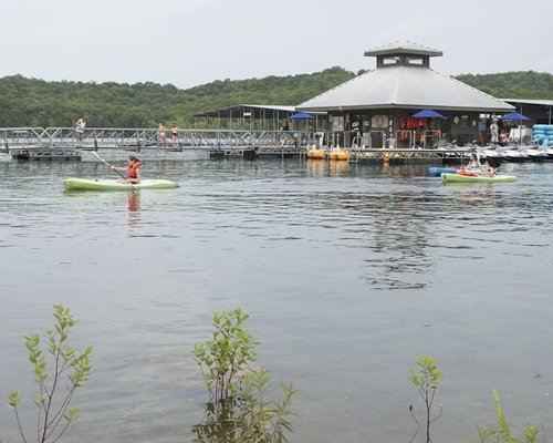 A view of the pier with kayaking and paddle boats.