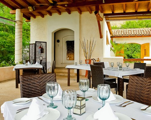 A fine dining area at the resort with an outside view.
