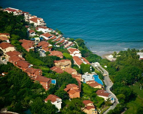 Birds eye view of the resort property alongside the ocean.
