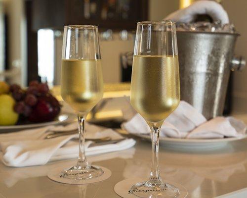 Close-up on wine glasses, Ice bucket and fresh fruit.