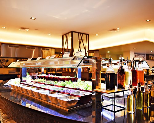 A salad-bar with a wide variety of selections.