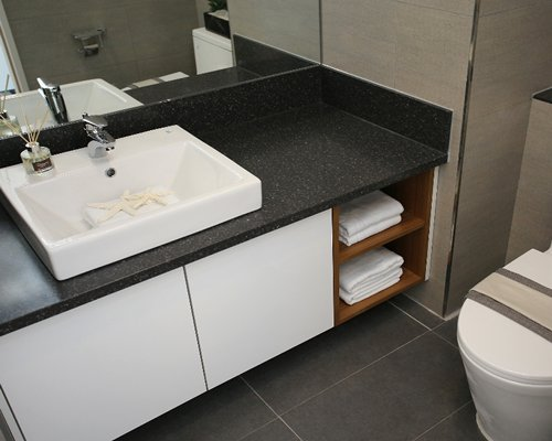 A bathroom with sink and vanity.