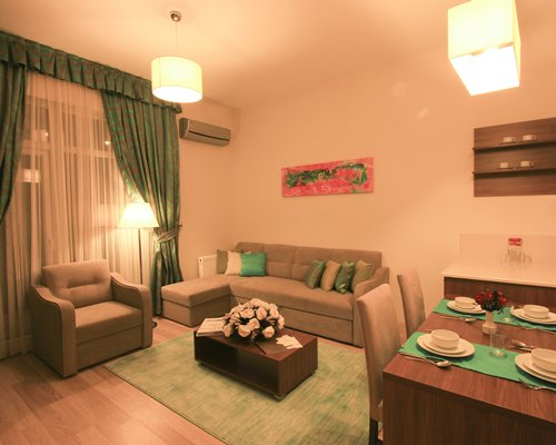 A well furnished living room and dining area.