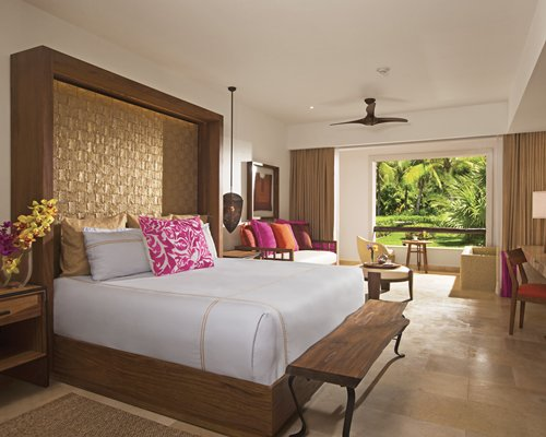 A well furnished bedroom and living area with an outside view.