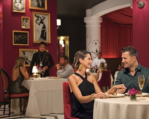 View of couples in an indoor fine dining restaurant.