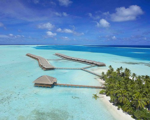 An aerial view of the Medhufushi Island Resort with trees.