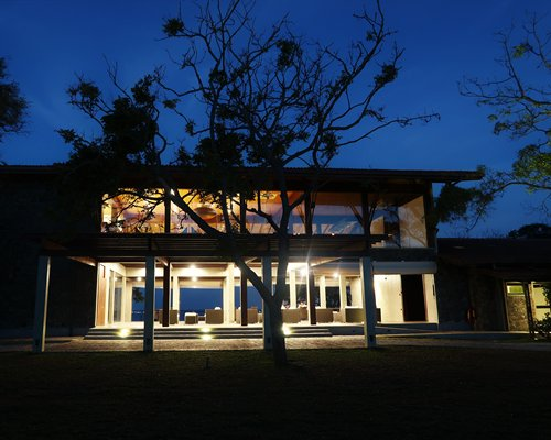 An exterior view of a resort unit at night.