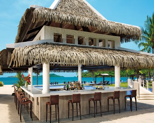Thatched hut outdoor bar.