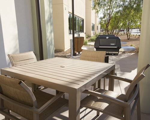 An outdoor dining area with a barbecue grill.