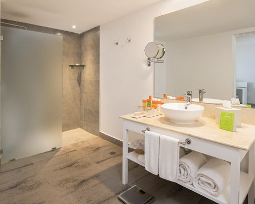 A bathroom with open vanity and bathing area.