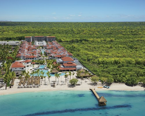 An aerial view of the resort property surrounded by wooded area alongside the waterfront.