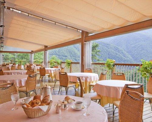 Balcony with a restaurant and view of mountains.