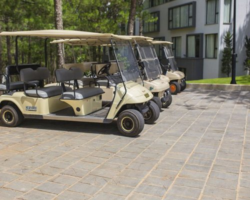 View of electric vehicle golf carts alongside the resort.