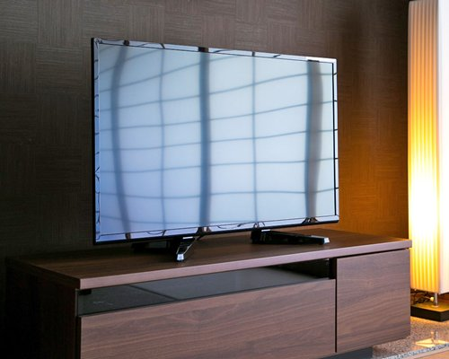 A well furnished living area with a television.
