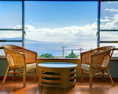 A view of patio furniture with the ocean view.