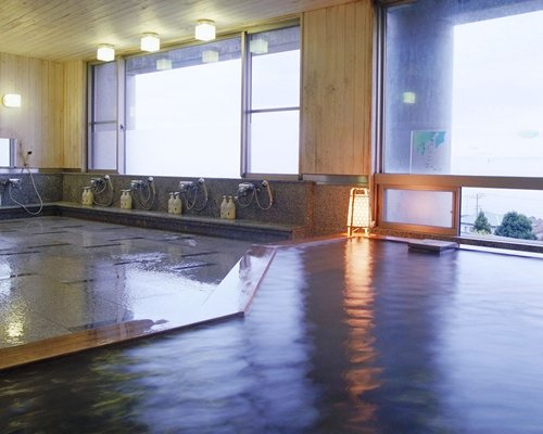 An indoor area with multiple showers.