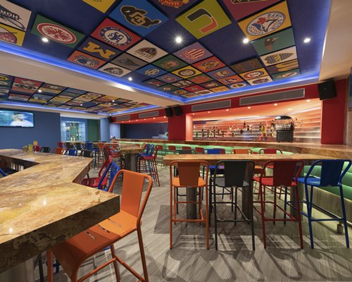 Colorful resort restaurant with clothed tables