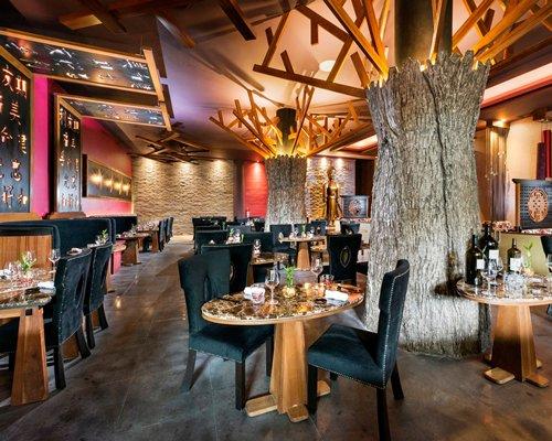 An indoor restaurant at El Dorado Seaside Suites A Gourmet Inclusive Resort.
