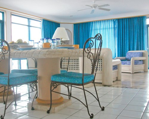 A well furnished living room with dining table.