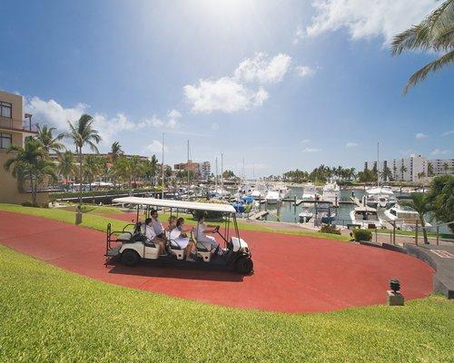 Outdoor recreation area with putt putt golf course alongside multiple balconies.