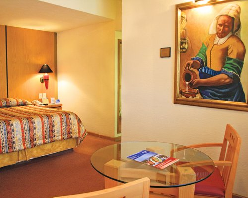 A well furnished bedroom with lamps.