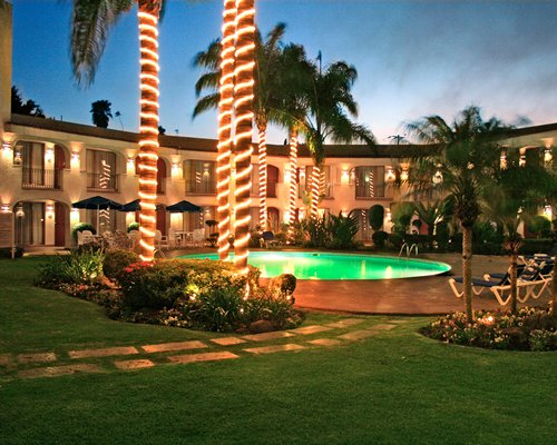 Scenic exterior view of the resort with an outdoor swimming pool at night.