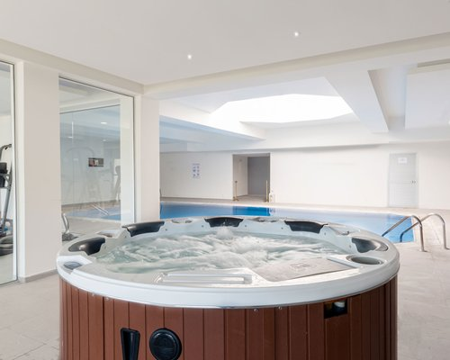 An indoor swimming pool and hot tub.